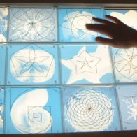 Interactive pattern matching game devised by Richard Henry for British Library installation, in which children move incised panels over illuminated graphics.
