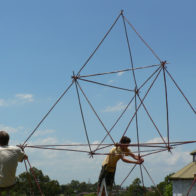 Children work independently to create giant modular tetrahedral structure
