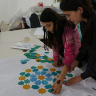 PSTA familiy drop in workshop led by Richard Henry. Participants explore tessallation with pieces produced by stencils.