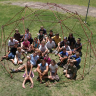 Children sit within completed geodesic structure