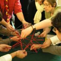 Teacher explore a geometrry structure workshop.