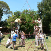 Children work independently to create giant modular tetrahedral structure.