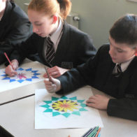 Pattern and collage progect led by Richard Henry. Students decorate their own geometric designs.