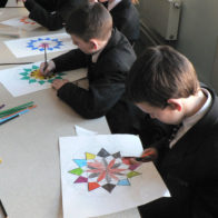 Pattern and collage progect led by Richard Henry. Students cut out their individual decorated designs.