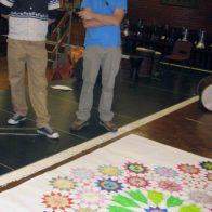 Artists Mahmoud Al-Hourami and Richard Henry consider the final design.