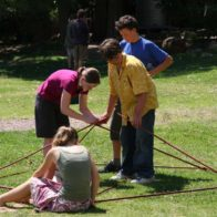 Children assemble individual module of geodesic dome