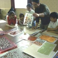 Richard Henry demonstrates stencilling technique.
